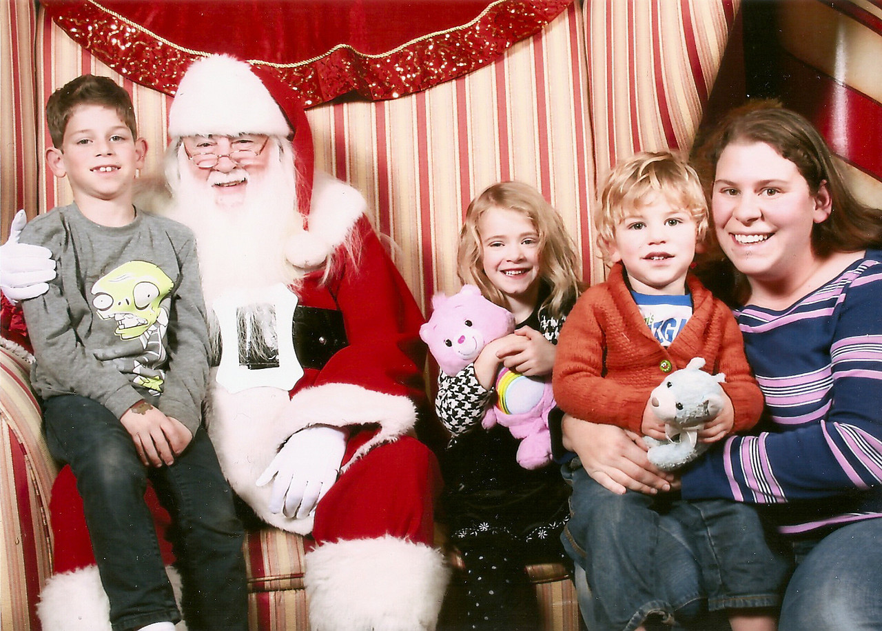 Day 354/1450 - Santa took a quick break from his busy preparations at the North Pole to take a picture with the kids just five days before Christmas.