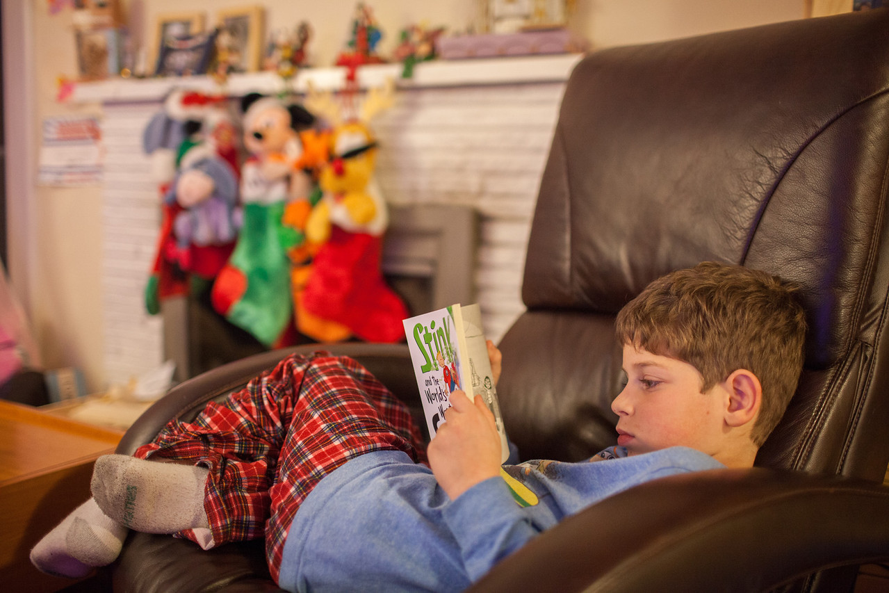Day 365/1461 - Corey is winding down his New Year's Eve with a new book after a fun night celebrating with friends. He's the only one that made it up to midnight, reading in his bed.