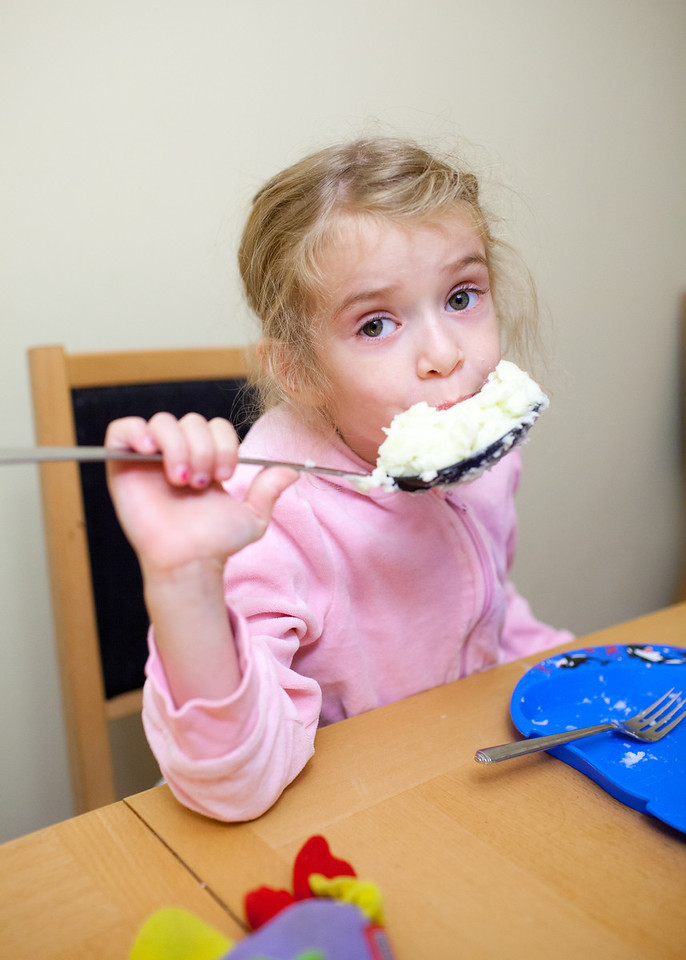 Day 333/1428 - She's getting her appetite back and requested to lick the spoon for the last of the mashed potatoes.